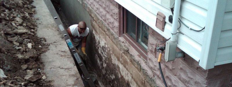 man performing foundation reinforcement work