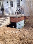 porch foundation exposed for waterproofing